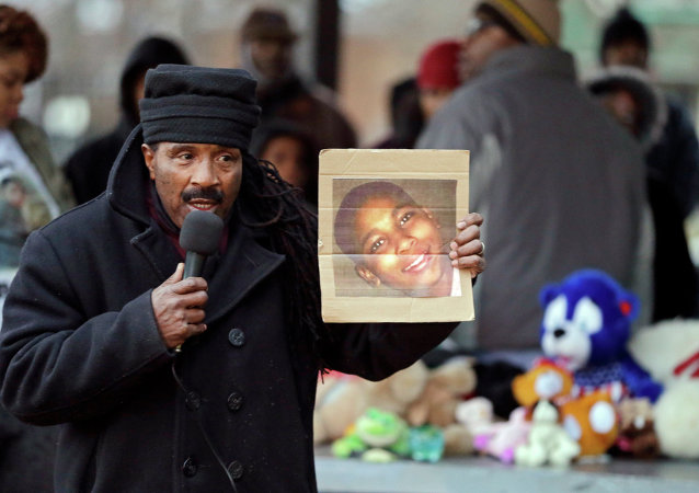 Activist Art McCoy holds a photo of Tamir Rice before a protest march at Cudell Park in Cleveland, Ohio.