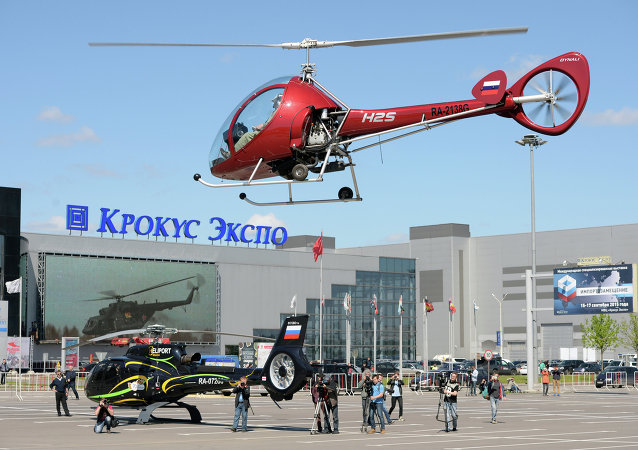 A Dynali H2S helicopter by Moscow's Crocus Expo exhibition hall before the HeliRussia 2015 expo.