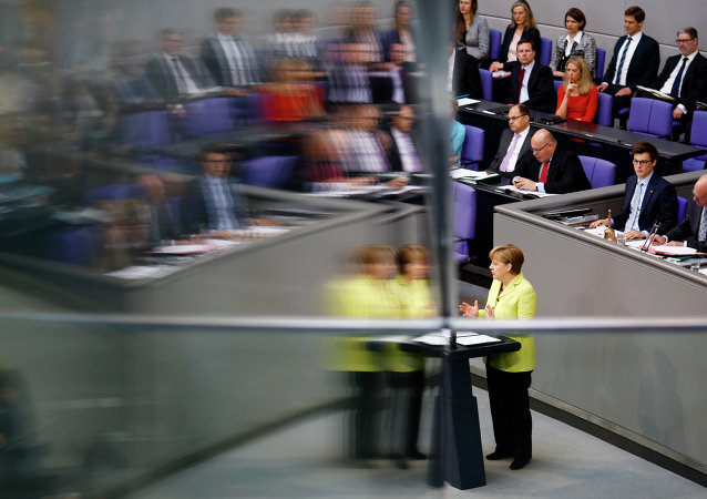 German Chancellor Angela Merkel is reflected in a window pane as she delivers a government declaration about the European Union and an Eastern Partnership with former Soviet Republics at the German parliament Bundestag in Berlin, Germany, Thursday, May 21, 2015.