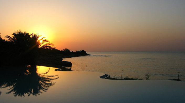 An infinity pool at a private beach hotel on the south coast of Sardinia.