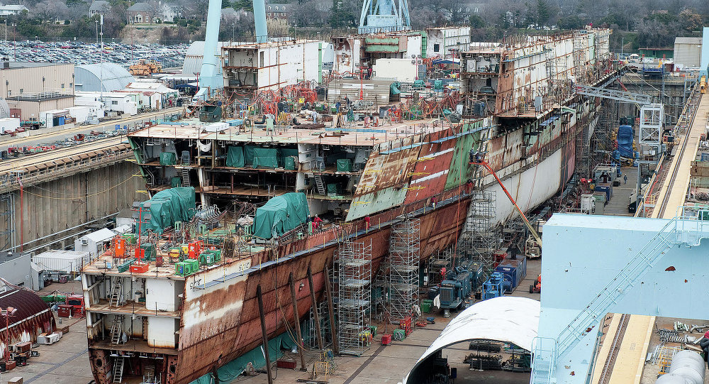 The USS Ford - seen here under construction in 2012 - ran $2 billion over budget but the Navy promised most of those costs were due to its being the first of its class and would not recur with the USS Kennedy.