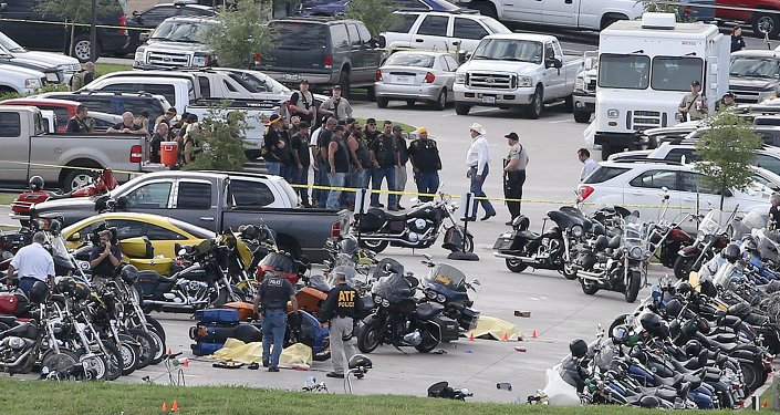 Authorities investigate a shooting in the parking lot of the Twin Peaks restaurant Sunday, May 17, 2015, in Waco, Texas