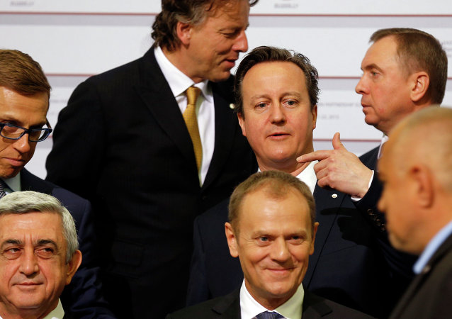 British Prime Minister David Cameron, third right, gestures during a group photo at the Eastern Partnership summit in Riga.