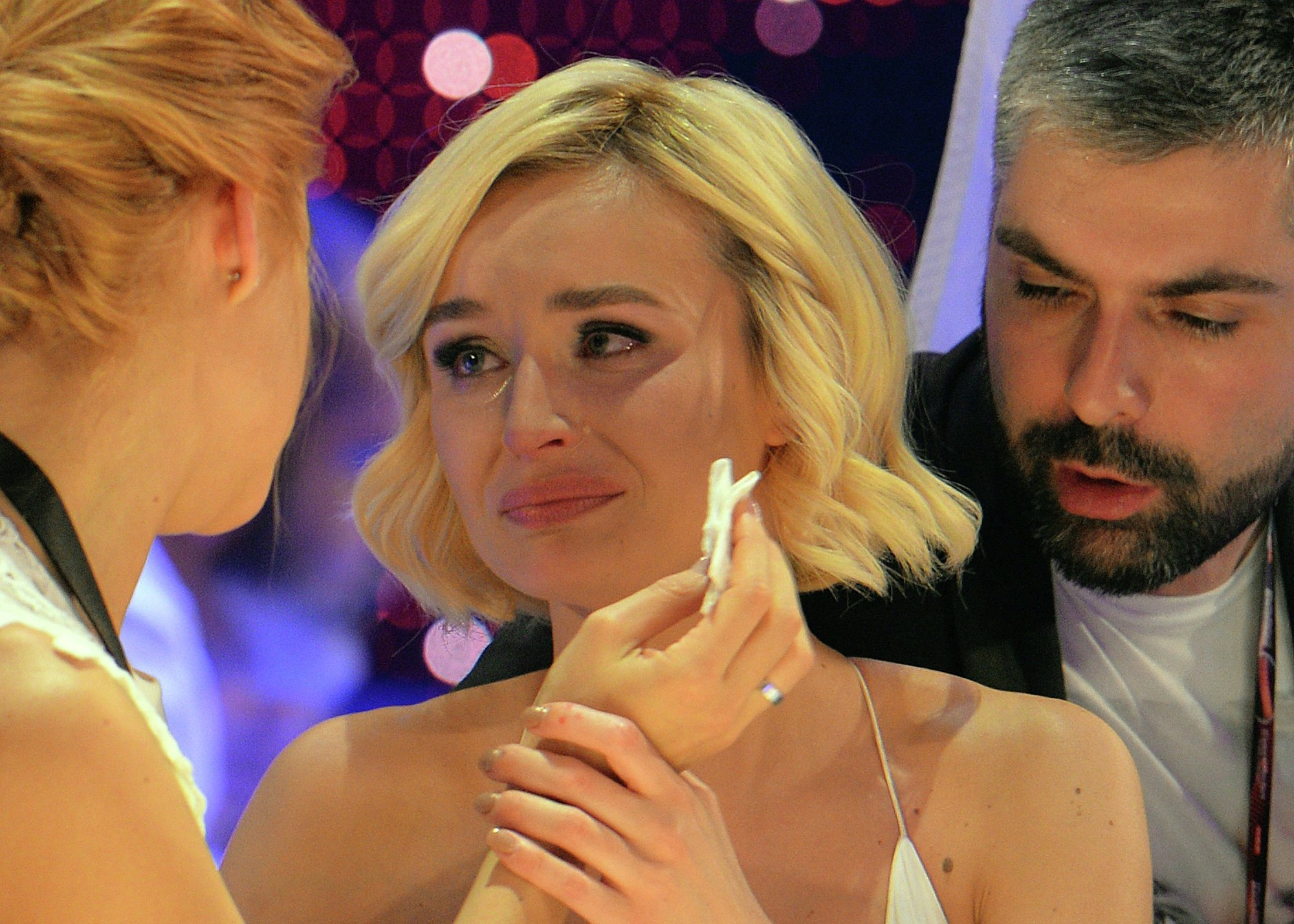 Polina Gagarina representing Russia, centre, reacts as the results start to come in during the final of the Eurovision Song Contest in Austria's capital Vienna, Saturday, May 23, 2015