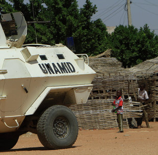 UN-African Union mission to Darfur (UNAMID) vehicle patrols a street in the city of Nyala in Sudan's Darfur, on November 5, 2014