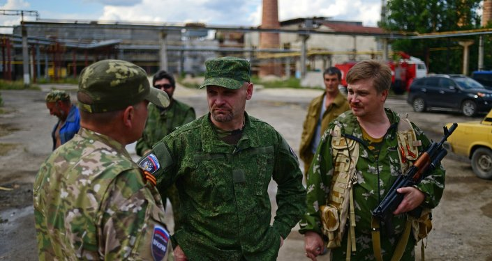 Center: Alexei Mozgovoi, commander of the Prizrak (Ghost) battalion of the Lugansk People's Volunteer Corps, speaks with his soldiers in Lisichansk where the battalion is stationed
