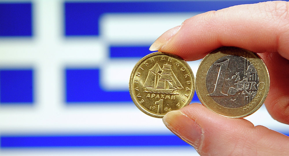 A person holding a 1 euro coin (R) and Greek 1 drachma coin in front of a Greek national flag