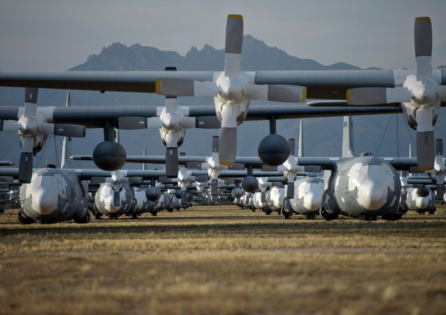 C-130 Hercules cargo planes are lined up in a field at the 309th Aerospace Maintenance and Regeneration Group boneyard at Davis-Monthan Air Force Base in Tucson, Ariz