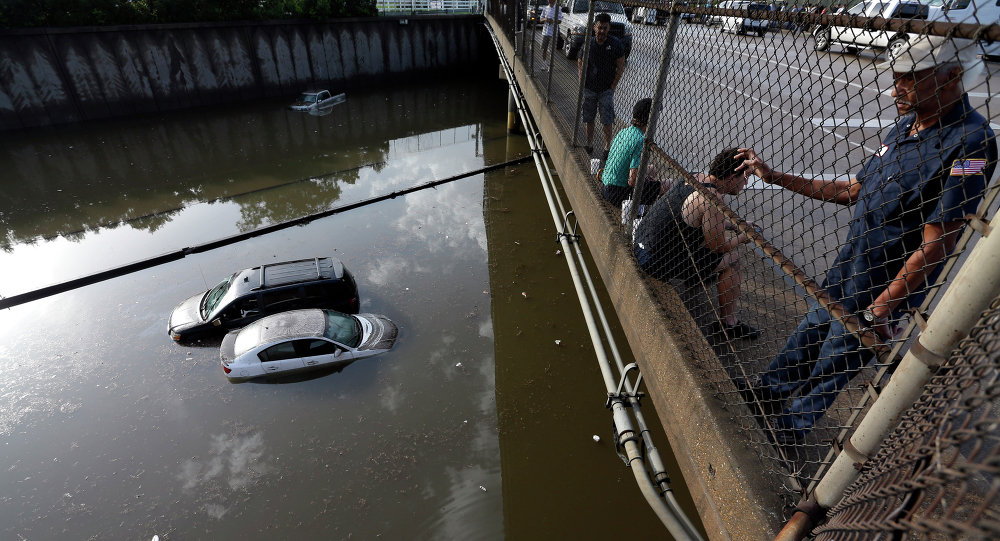 Cars sit in floodwaters along Interstate 45 after heavy overnight rain flooded parts of the highway in Houston, Tuesday, May 26, 2015.