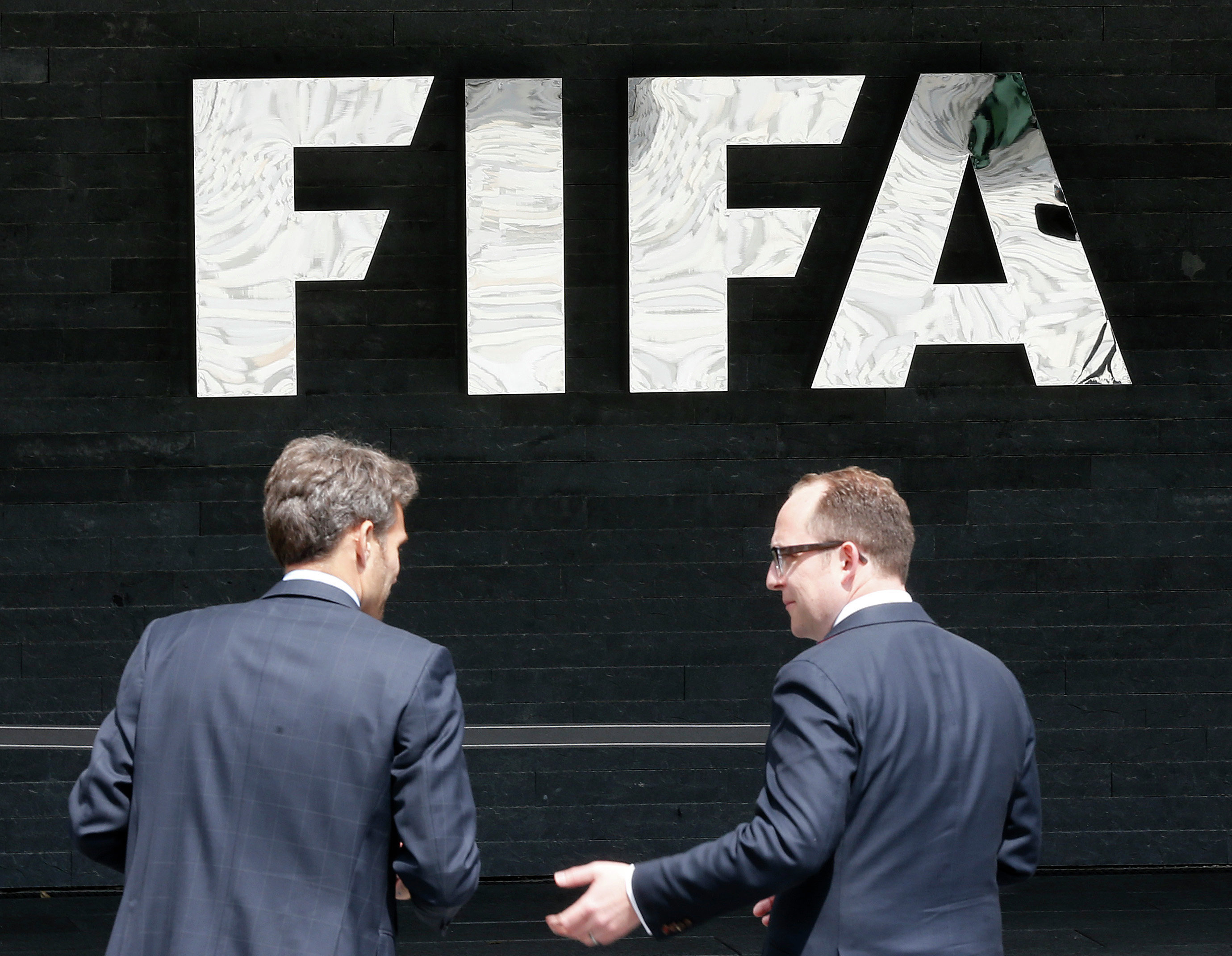 As top football executives in the Americas are losing their positions over the FIFA corruption investigation, the timing of the revelations - on the eve of the FIFA's presidential elections - seems to some designed for a shake up.