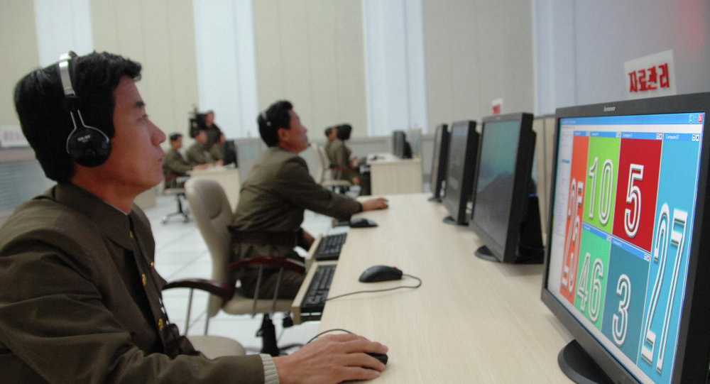 Scientists and technicians work on their computers to control the launch of North Korea's Unha-3 rocket at the General Satellite Control and Command Center on Wednesday