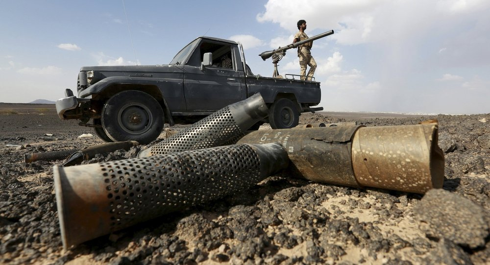 A fighter of the anti-Houthi Popular Resistance Committees stands on a truck during fighting with Houthi fighters near Yemen's northern city of Marib May 29, 2015