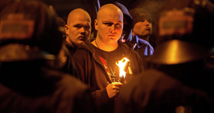 A neo-Nazi surrounded by riot police holds a torch during a rally to commemorate the 68nd anniversary of the bombing of Dresden