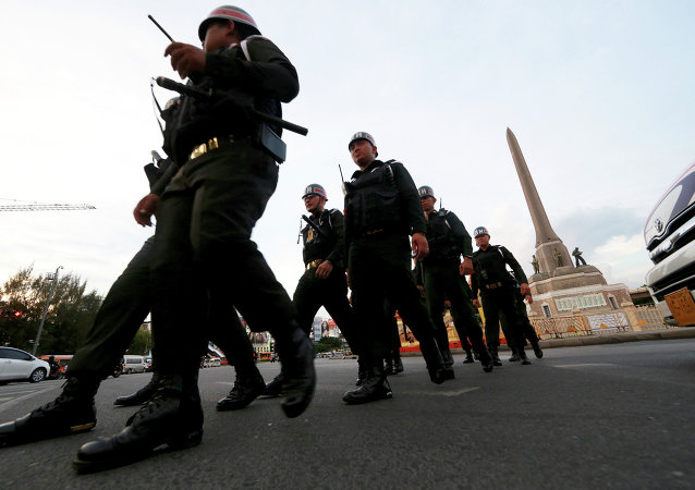 Thai military police officers march while guarding to prevent anti-coup demonstration at Victory Monument