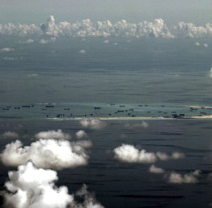 An aerial file photo taken though a glass window of a Philippine military plane shows the alleged land reclamation by China on Mischief Reef in the Spratly Islands in the South China Sea, west of Palawan, Philippines, May 11, 2015