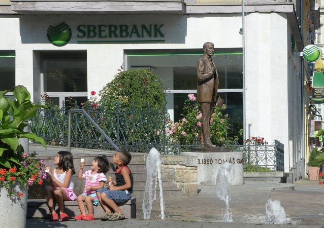 Monument to the first president of Czechoslovakia Tomas Masaryk outside a branch of Russia's Sberbank in Karlovy Vary