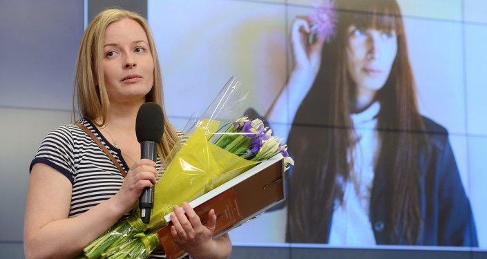 Winner of the Andrei Stenin International Press Photo Contest's Grand Prix Yelena Anosova at the award ceremony held at the Rossiya Segodnya International News Agency's International Multimedia Press Center