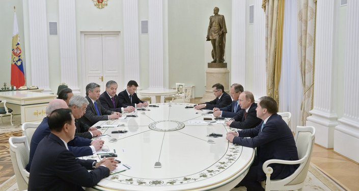 Russian President Vladimir Putin meets with attendees at SCO Council of Ministers of Foreign Affairs Meeting