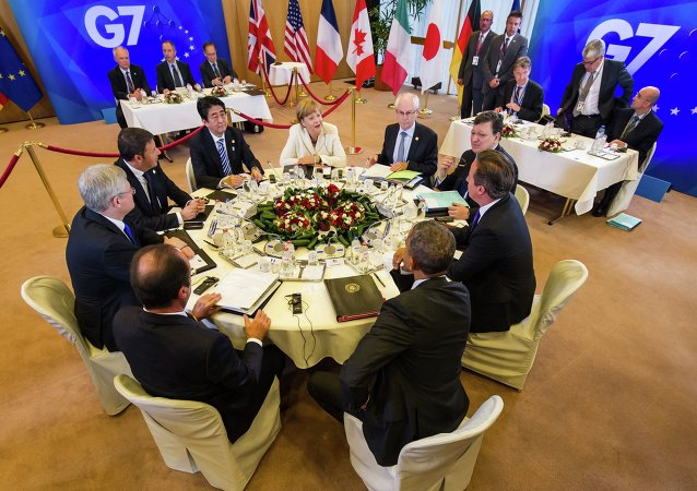 Group of 7 leaders from front center right clockwise, U.S. President Barack Obama, French President Francois Hollande, Canadian Prime Minister Stephen Harper, Italian Prime Minister Matteo Renzi, Japanese Prime Minister Shinzo Abe, German Chancellor Angela Merkel, European Council President Herman Van Rompuy, European Commission President Jose Manuel Barroso and British Prime Minister David Cameron a G7 summit at the EU Council building in Brussels