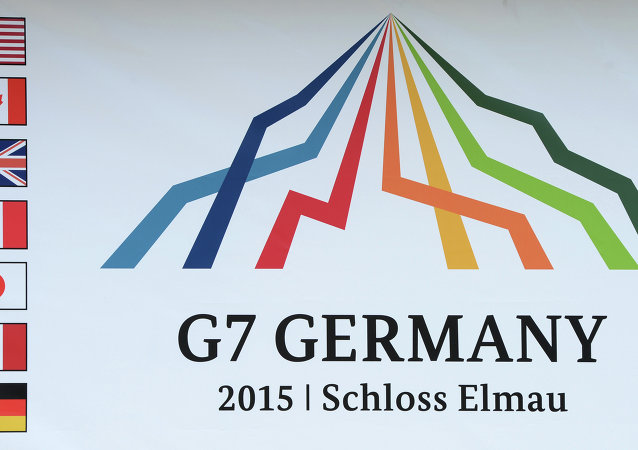 The sign of the Elmau G7 summit is pictured in the small Bavarian village Klais, southern Germany, at the access road to Schloss Elmau Castle near Garmisch-Partenkirchen on June 1, 2015