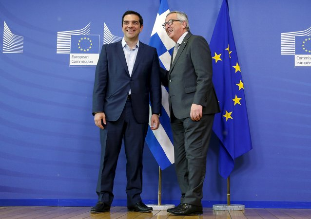 Greek Prime Minister Alexis Tsipras (L) poses with European Commission President Jean-Claude Juncker ahead of a meeting at the EU Commission headquarters in Brussels, Belgium, June 3, 2015