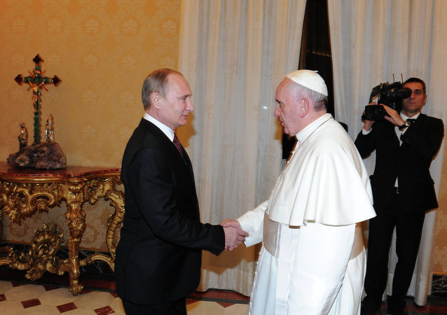 Russian President Vladimir Putin, left, during his meeting with Pope Francis in the Apostolic Palace of the Vatican, November 25, 2013