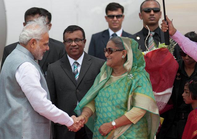 Bangladesh's Prime Minister Sheikh Hasina shakes hand with Indian Prime Minister Narendra Modi