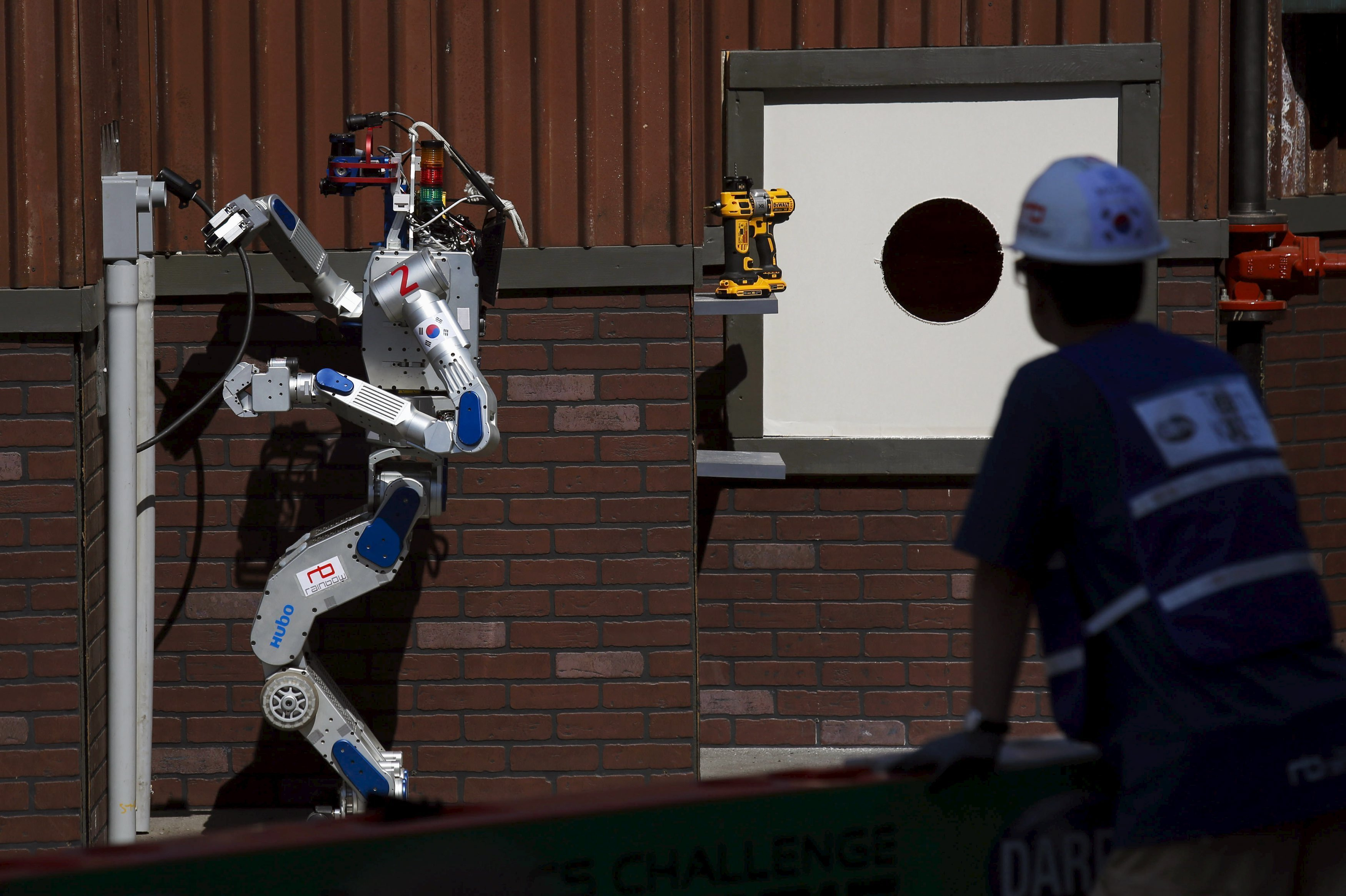 The Team KAIST DRC-Hubo robot completes the plug task before winning the finals of the Defense Advanced Research Projects Agency (DARPA) Robotic Challenge in Pomona, California June 6, 2015