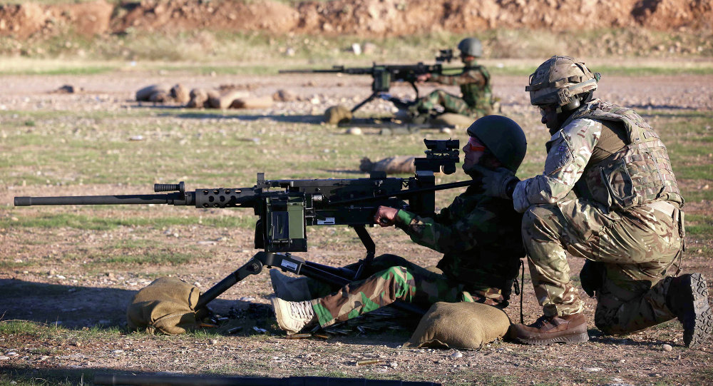 British military advisers instruct Kurdish Peshmerga fighters during a training session at a shooting range on the outskirts of Arbil, the capital of the autonomous Kurdish region of northern Iraq on November 5, 2014