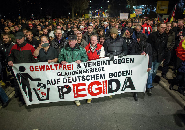 A picture taken on December 15, 2014 shows supporters of the PEGIDA movement, Patriotische Europaeer gegen die Islamisierung des Abendlandes, which translates to Patriotic Europeans Against the Islamification of the Occident, taking part in a rally in Dresden, eastern Germany. File photo