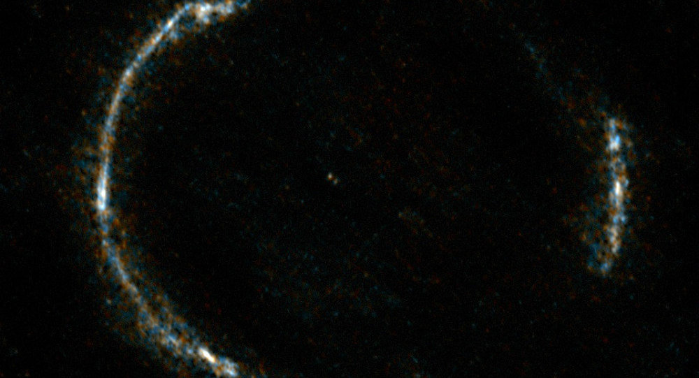 The gravitationally lensed galaxy SDP.81, which appears as an almost perfect Einstein Ring, is seen here.