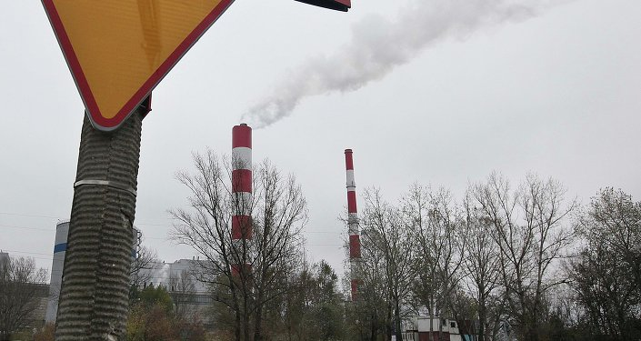 Smoke rises from a heat and power plant in Warsaw, Poland, Thursday, Oct. 23, 2014