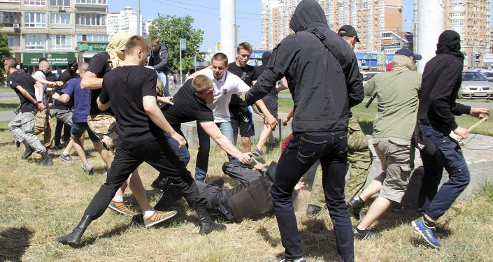 Anti-gay protesters attack a policeman during the so-called Equality March, organized by a lesbian, gay, bisexual and transgender (LGBT) community, in Kiev, Ukraine, June 6, 2015