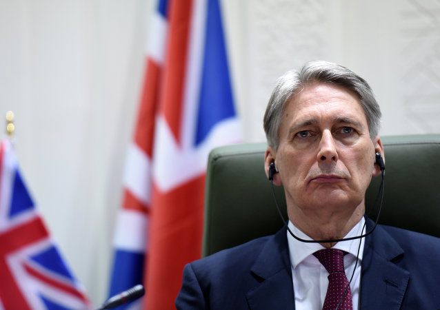 British Foreign Secretary Philip Hammond listens during a joint press conference with Saudi Foreign Minister Prince Saud bin al-Faisal bin Abdulaziz (not pictured) after a meeting on March 23, 2015 in Riyadh