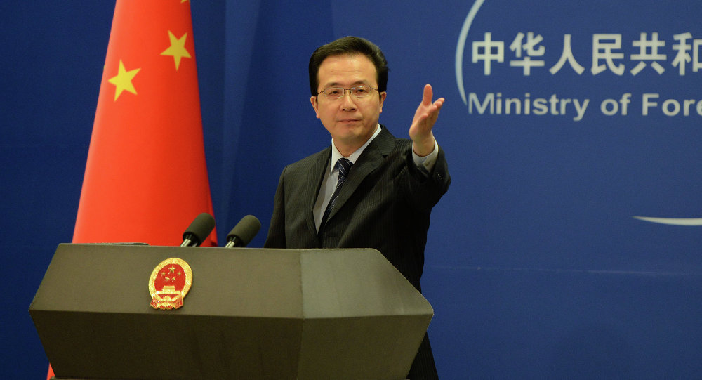 The Chinese Foreign Ministry spokesman Hong Lei gestures during a press briefing in Beijing on April 8, 2013