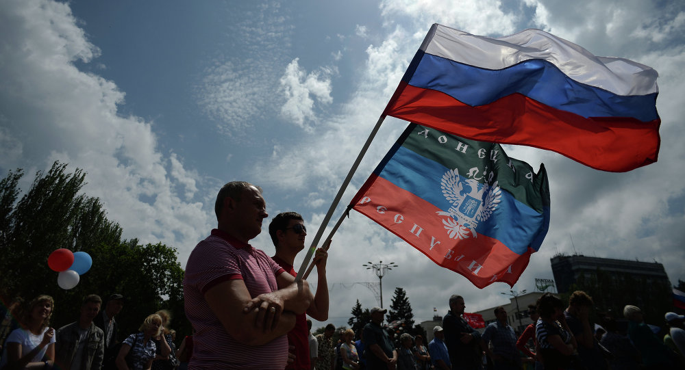 Participants at the rally in support of the Donetsk People's Republic on Lenin Square in Donetsk