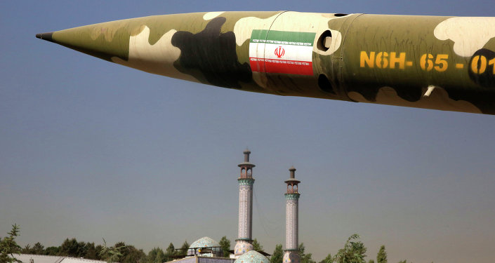 A missile is displayed at an exhibition on the 1980-88 Iran-Iraq war, at a park, northern Tehran, Iran, Thursday, Sept. 25, 2014