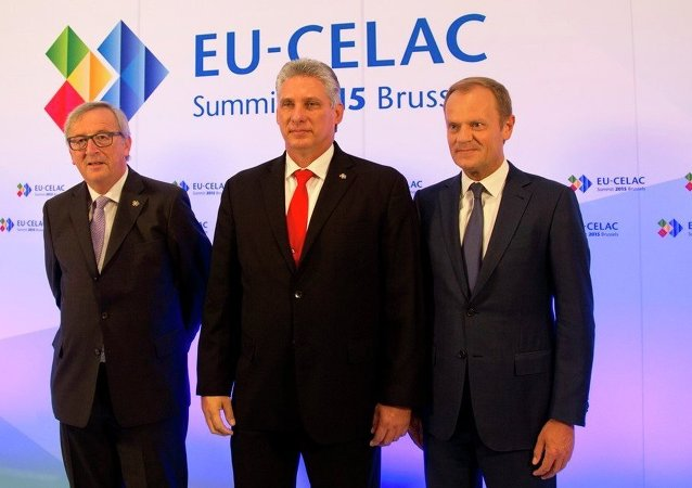 European Commission President Jean-Claude Juncker, left, and European Council President Donald Tusk, right, welcome Cuba's First Vice-President Miguel-Canel Bermudez.