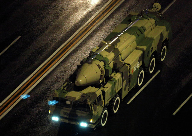 A Chinese military vehicle carries a DF21 medium range ballistic missile.