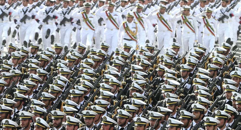 Iranian navy troops march in a parade marking National Army Day
