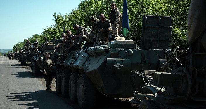 Column of Ukrainian forces stops for a rest not far from eastern Ukrainian city of Artemivsk, Donetsk region