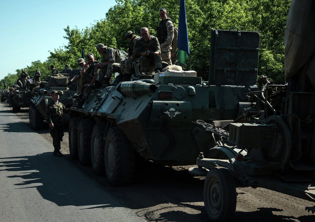 Column of Ukrainian forces stops for a rest not far from eastern Ukrainian city of Artemivsk, Donetsk region
