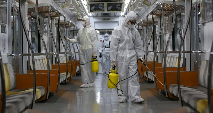 Workers in full protective gear disinfect the interior of a subway train at a Seoul Metro's railway vehicle base in Goyang, South Korea, June 9, 2015