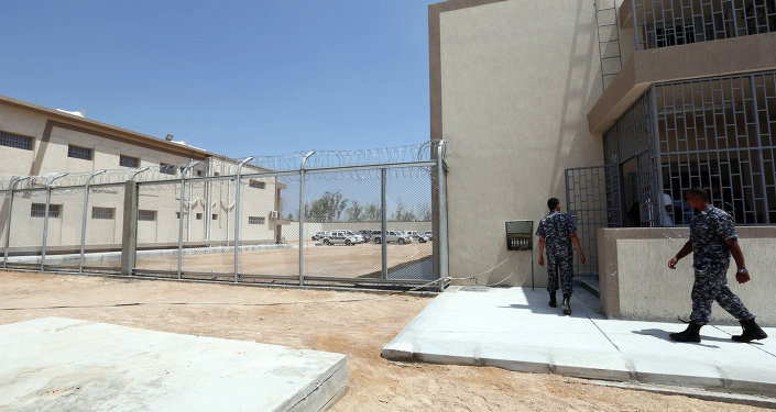 Security walk in the newly inaugurated Reform and Rehabilitation center of Al-Gauia on August 13, 2013 in Libya's coastal city of Misrata