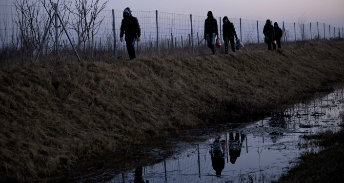 FILE - In this Feb. 17, 2015 file photo Afghan migrants trek their way to the Serbian border with Hungary close to Hajdukovo, 150 kilometers north of Belgrade, Serbia