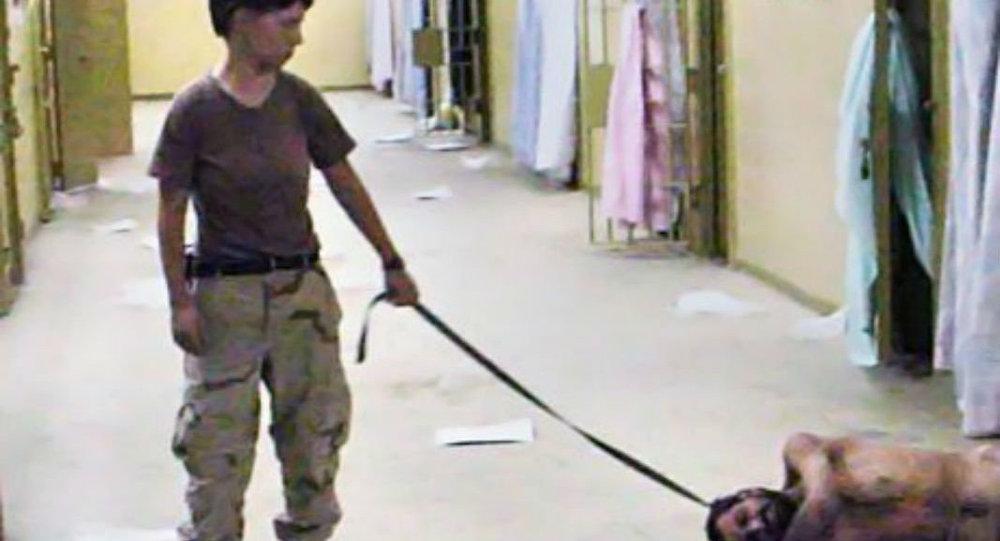 Specialist Lynndie England abusing an inmate in Abu Ghraib.
