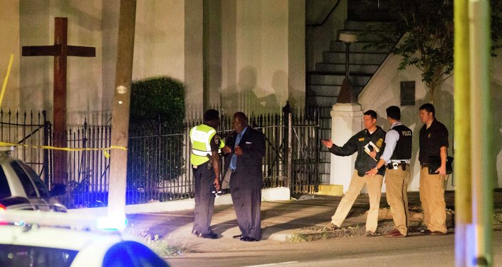 Police stand outside the Emanuel AME Church following a shooting Wednesday, June 17, 2015, in Charleston, S.C.