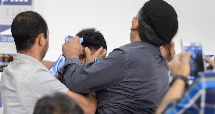 People clash at a press conference held by Yemeni rebels at the Geneva Press Club on June 18, 2015 in Geneva