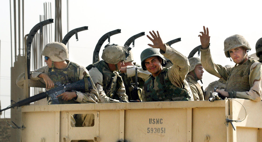 US Marines wave goodbye as they leave the military headquarters in Najaf in central Iraq, 23 September 2003