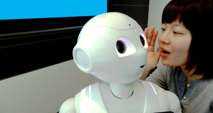 IBM Research - Tokyo is IBM Researcher Risa Nishiyama with SoftBank's Pepper robot using Watson in a demonstration environment